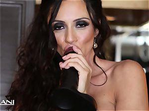 Ariella Ferrara plunges a immense ebony faux-cock in her cooch