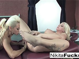 Nikita gets a loosening massage from Leya