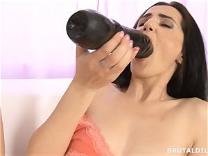 Raven haired honey shoots a load on big faux-cock and gobbles it clean