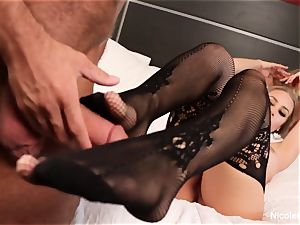 fantastic Nicole Aniston gives her man a footjob