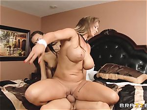 Eva Notty displays her stepdaughter Janice Griffith how to sate a wood
